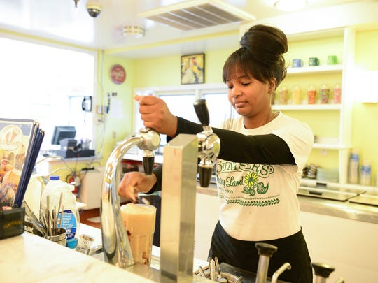 Kiera Victor, Soda Jerk at Dumser's Dairyland Restaurant, makes a milkshake on Tuesday, Nov. 7, 2017.