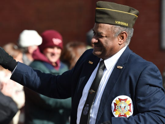 Frank Darcus carries a VFW banner during the  2017