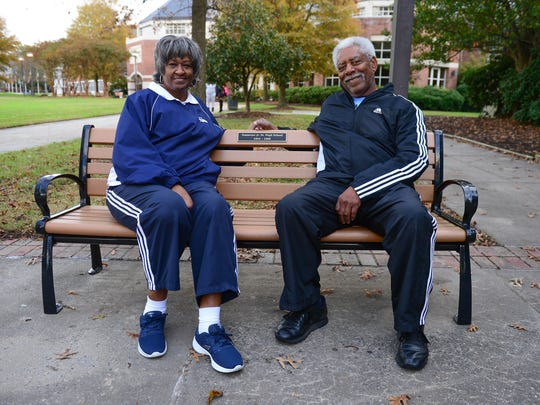 Alumni and former staff members of Somerset High School Billy Dennis, Class of 1961, Cecelia Griffith Dennis, Teacher, sit on a bench donated by Alumni outside of the former Somerset High School located in Princess Anne, Thursday, Nov. 9, 2017.
