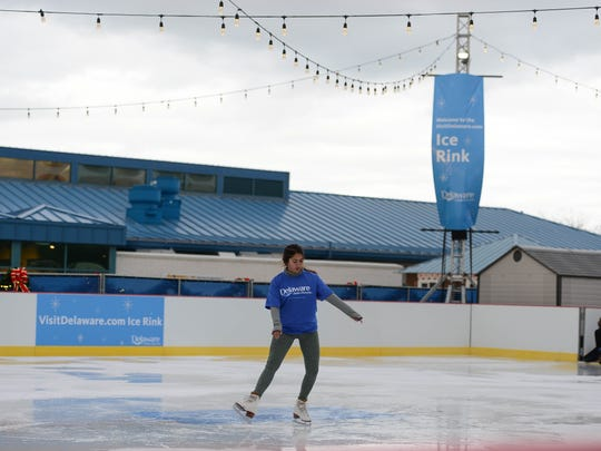 """Victoria VanMeter, volunteer, tests out the """"Visit Delaware Ice Rink"""" at the Winter Wonderfest Center located at the Cape May-Lewes Ferry Terminal and also in the Cape Henlopen State Park. That will run Nov. 17 to December 31, 2017."""