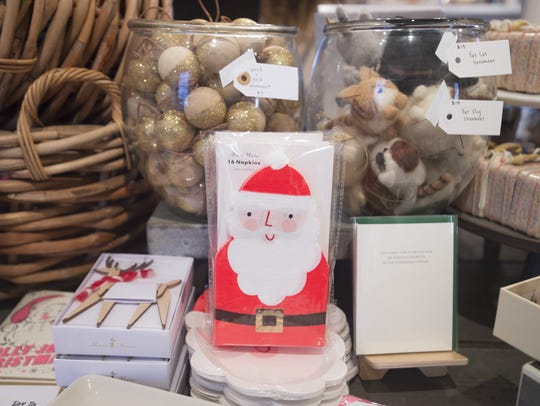 Holiday gifts line the shelves at Knapsack on Friday,