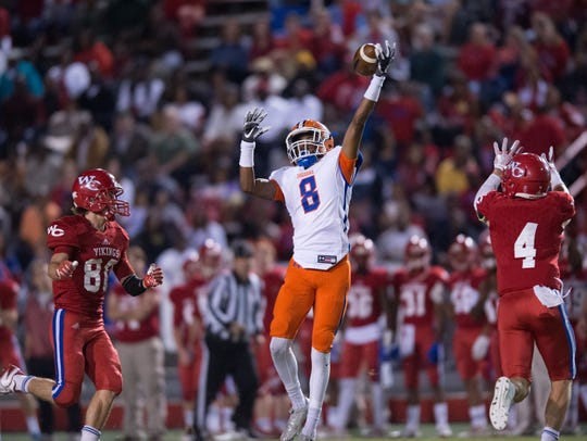 Madison Central's Myles Hopson tries to catch a pass