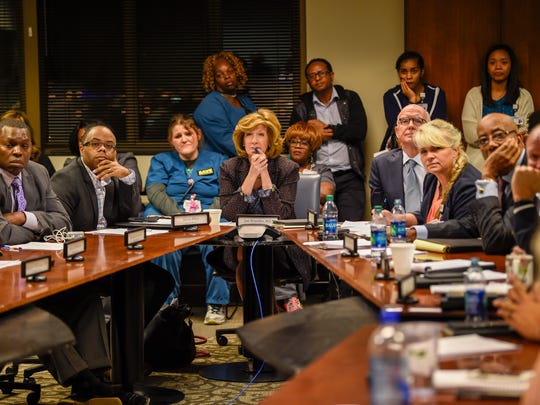 Board members and the community listen as people express their opinions about the possible end of in-patient services at Nashville General to the Hospital Authority Board during a meeting at the Nashville General Hospital in Nashville, Tenn., Friday, Nov. 17, 2017.