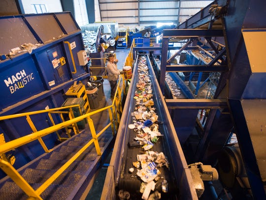 At least 25 tons of recycled waste is processed through the St. Lucie County Single-Stream Recycling Facility each hour, seen Nov. 16, 2017, at the facility in Fort Pierce. Treasure Coast counties don't always meet the state's percentage mandates, with Martin County at 56 percent, St. Lucie County at 58 percent and Indian River County at 53 percent, according to the latest recycling statistics released this summer.