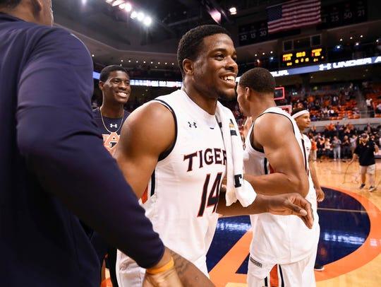 Malik Dunbar (14). Auburn basketball vs Winthrop on