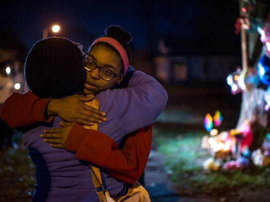 Brittney Young, sister of Janae Carter, hugs her aunt