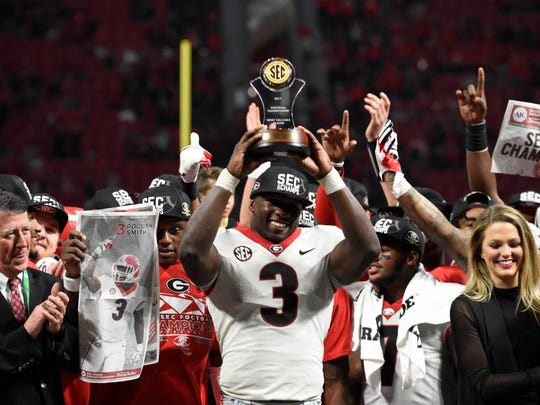 Dec 2, 2017; Atlanta, GA, USA; Georgia Bulldogs linebacker Roquan Smith (3) is awarded MVP after defeating the Auburn Tigers in the SEC Championship game at Mercedes-Benz Stadium.