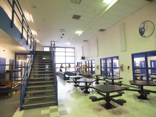 Inmates sit in lockdown procedure in the female housing