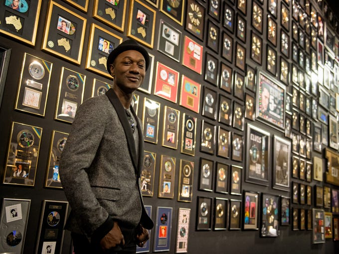 Aloe Blacc with Elvis Presley's wall of gold records