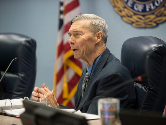Commissioner Ed Fielding speaks during the Martin County Commission meeting Dec. 12, 2017 at the Martin County Administration building in Stuart. Fielding and former commissioner Anne Scott were recently charged with violating public records law relating to a civil lawsuit with Lake Point Restoration, a rock quarry in western Martin County. Commissioner Sarah Heard pleaded not guilty to a noncriminal infraction related to violating state public records law.