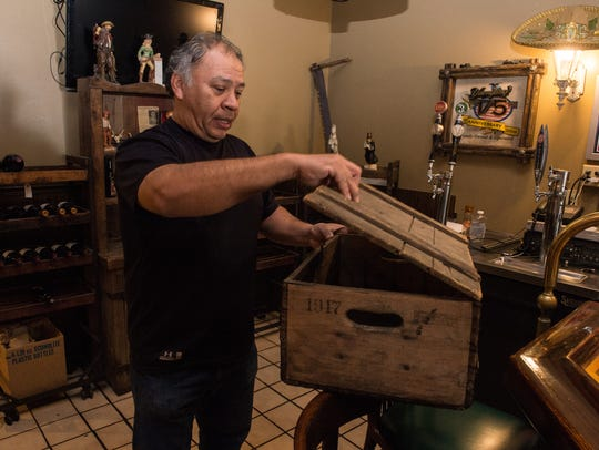Mart'n Sanchez opens an antique strongbox at Old West