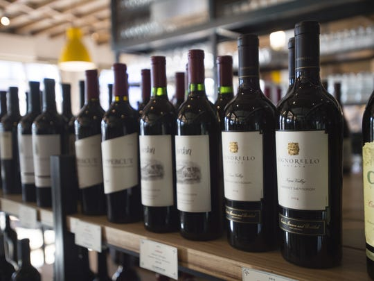 Bottles of wine sit on display at The Emporium on Tuesday, December 12, 2017. The new market and restaurant, attached to the Elizabeth Hotel offers select wines and cheeses.