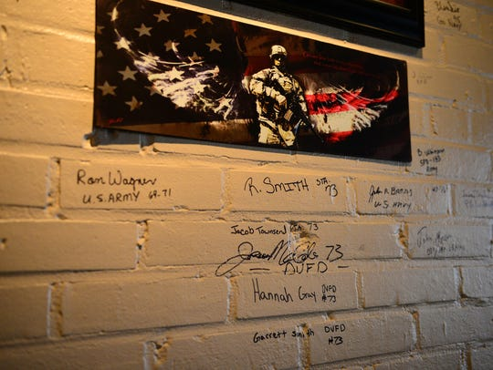 The valor wall is still in its beginning stages, but it now displays a few signatures from those currently serving in the military, veterans, firefighters, police officers and other public service workers.