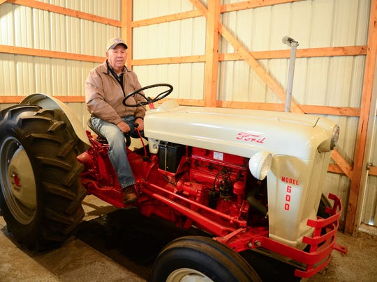 Wayne Wilkins sits on his first tractor he purchased when he was 17 years old. Wayne's farm was recognized as a 2017 Delaware Century Farm. Friday, Dec. 22, 2017.