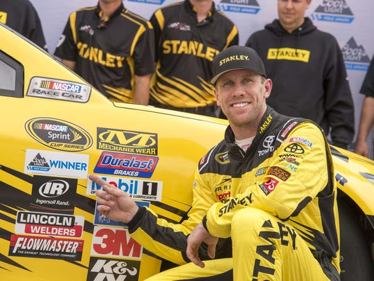 Carl Edwards celebrates in victory lane after wining
