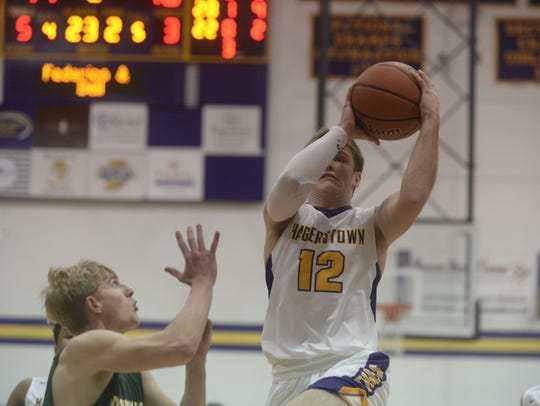 Hagerstown's Cody Swimm (12) goes for a layup during