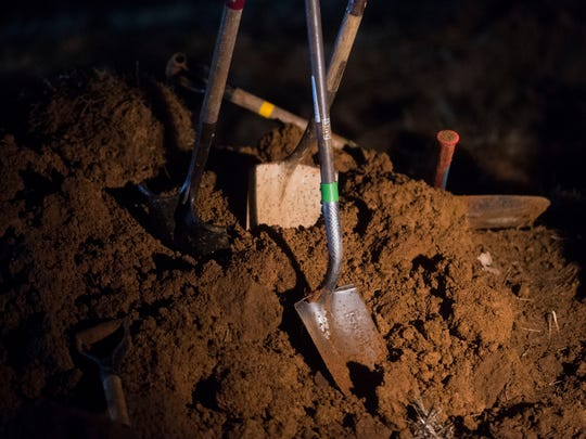 Shovels stand in dirt after members of Knoxville Volunteer Emergency Rescue Squad attempted to rescue a horse named Peanut who fell into a sinkhole in East Knox County, Wednesday, Jan. 10, 2018. Peanut did not survive.