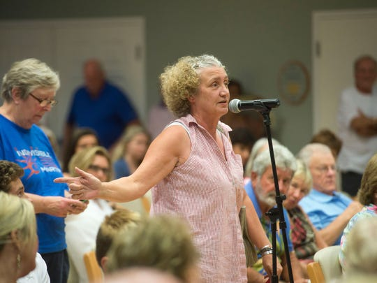 Sue Fox, of Palm City, asked U.S. Rep. Brian Mast about
