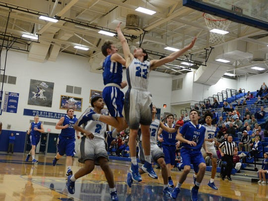 Fort Defiance's Jacob Jones tries to score against