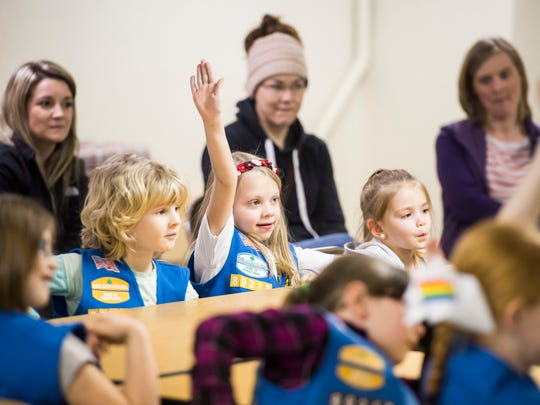 "Lilah Groft, 6, raises her hand in response to a question following a reading of ""The Too Small Elephant"" by author Christine Callahan during a Girl Scouts meeting at St. Paul's United Chuch of Christ in New Oxford Borough Tuesday."