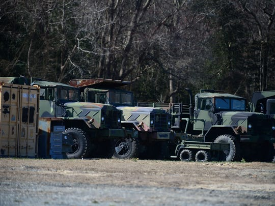 A few of the federal surplus vehicles that the Dewey Beach Police Department has stored outside city limits.