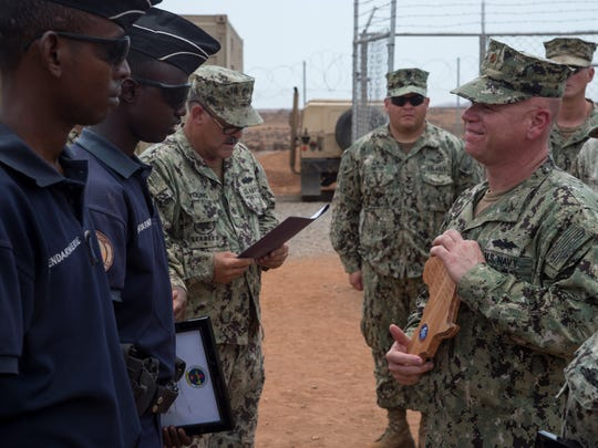 U.S. Navy Lt. Cmdr. Jason Ward of Henderson recognizes Djiboutian Gendarmerie for securing Seabees assigned to Combined Joint Task Force-Horn of Africa gathered on a construction site at Ali Oune, Djibouti, where they are building a medical center, Aug. 17, 2017. The project was started by Naval Mobile Construction Battalion ONE (NMCB 1) and is being relieved by NMCB 133, which will continue working on the project with plans for completion in 2018.