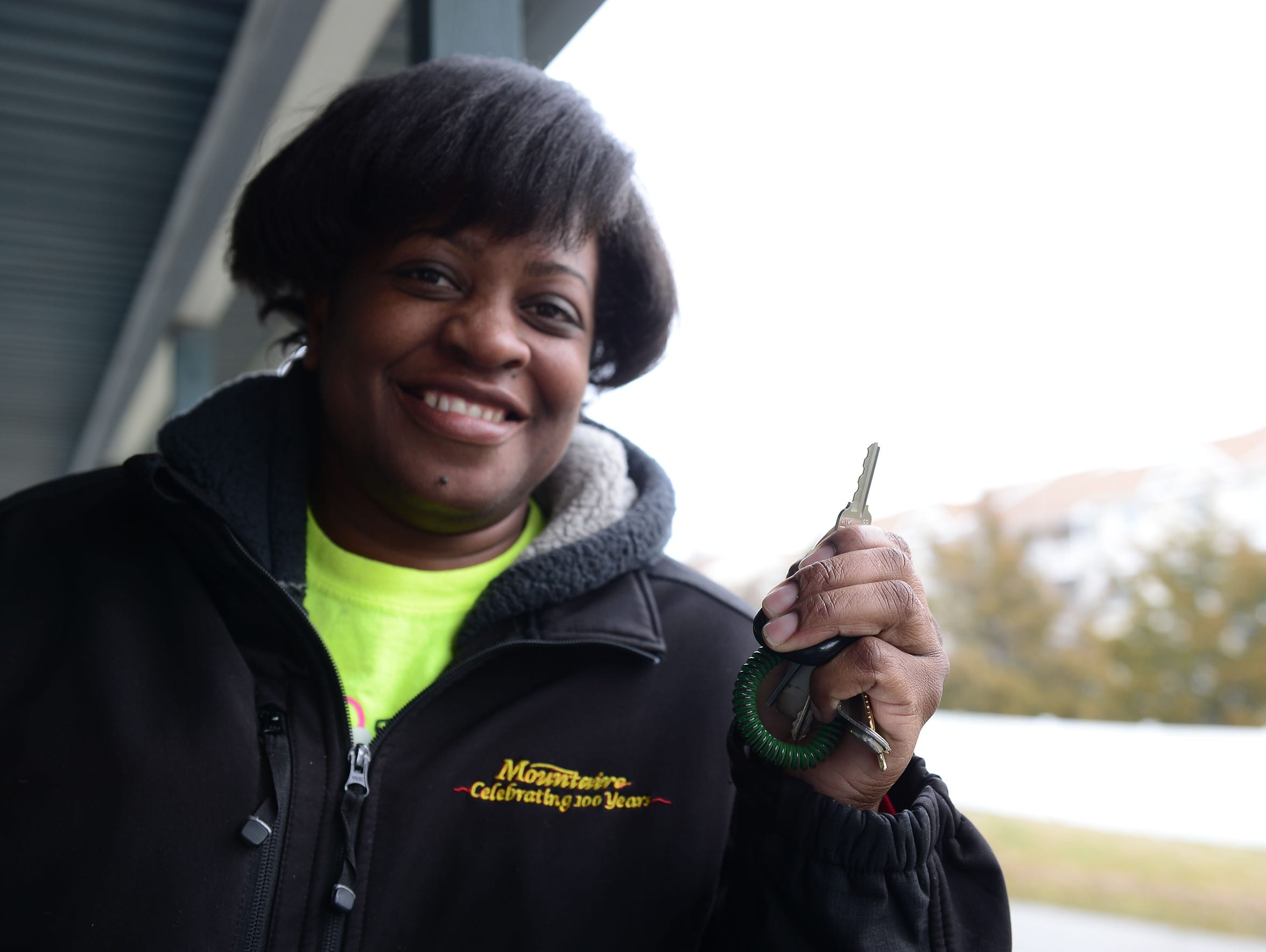 Rebecca James holds the key to her new home. After