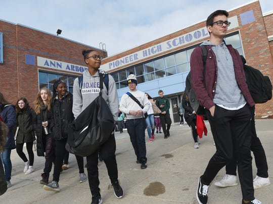 Students participate in a walkout to protest gun violence at Pioneer High School in Ann Arbor, Mich.