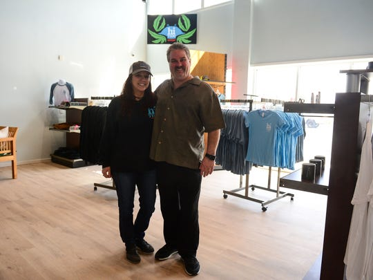 Bob and Sherri Davis, Hi Tide Clinical Director/ Part Owners, stands in the lobby of their dispensary store located in West Ocean City, Md.