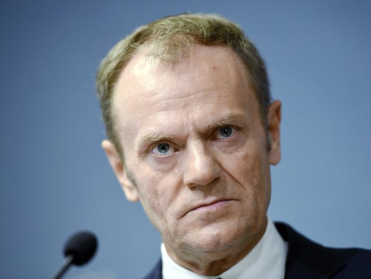 European Council President Donald Tusk pauses during