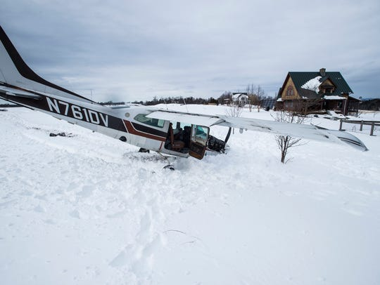 A single-engine plane rests in the front yard of a home on Dorset Street in Shelburne after an emergency landing there Friday, March 16, 2018. The pilot walked away from the crash and no one else was injured.