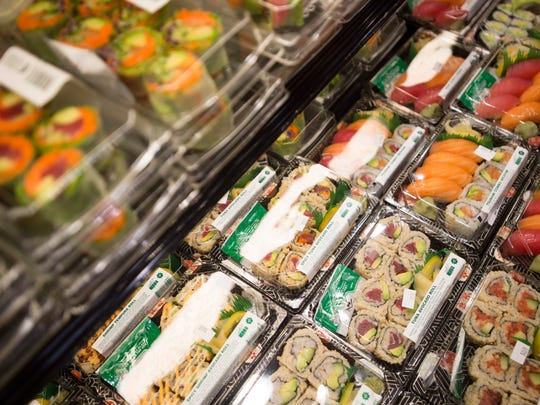 Sushi rolls sit available for purchase at Whole Foods in Fort Collins on Friday, March 15, 2018. The grocery chain has been offering a salad bar and other prepared foods for quick meal options since it opened in 2004.