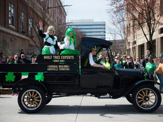 Riders on floats wave to the crowd during Knoxville's St. Patrick's Day festivities March 17, 2018.