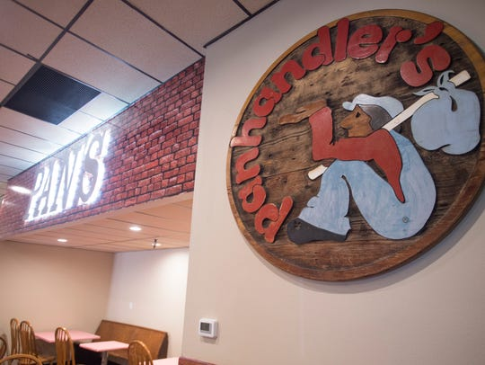 An original sign hangs at Panhandler's Pizza on Saturday,