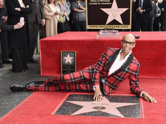 RuPaul poses with the new star.
