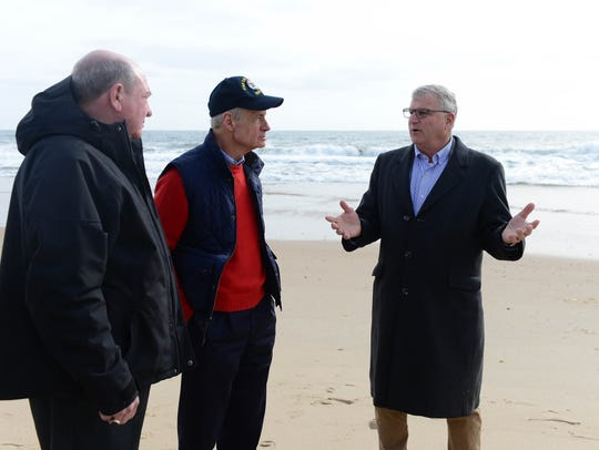 Sen. Tom Carper, Assistant Security Army Civil Works R.D. James and Tom Pratt, administrator, Shoreline and Waterway Management Section, talk about beach erosion in Bethany Beach on Tuesday, March 27, 2018 after a series of nor'easters greatly eroded the beach.