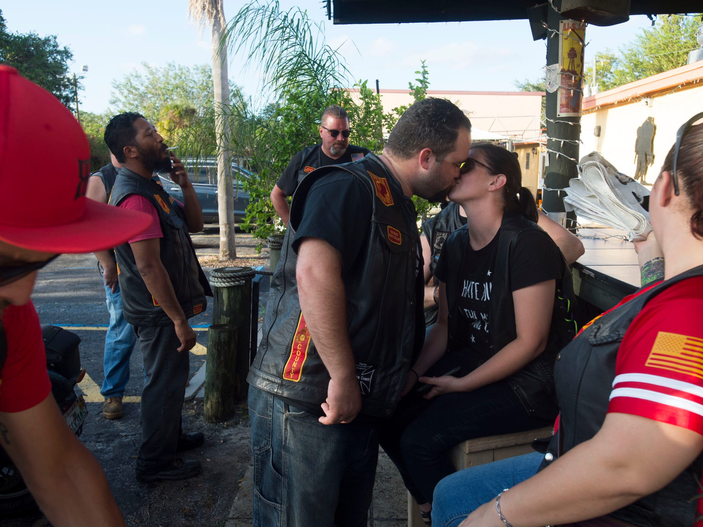 "A year after David Merrill's final separation from Jen, he reignited a relationship with an old friend, Becca, and the couple is going strong. They share a kiss at a fundraiser thrown by about a dozen area motorcycle groups, including his group, Leathernecks Martin County, on Oct. 14, 2017, at the Amvets Post 92 in Rio. The duo first met in 2008, before David left for the Marine Corps, but they had no contact for seven years. When they reconnected, ""it was an instant thing like we never missed a day or anything,"" David said. ""Being with her has been a complete turnaround."""