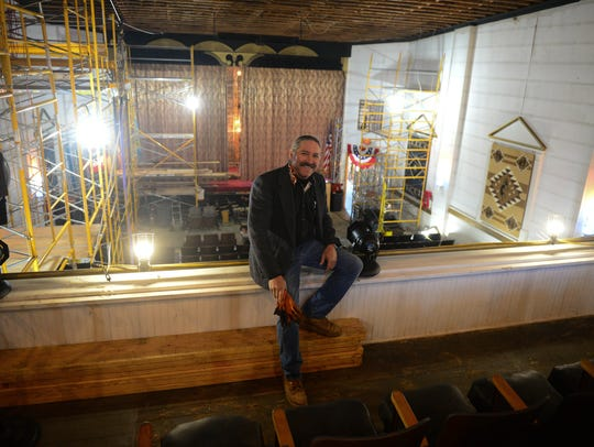 Eric Clarke, owner, sits in the mezzanine of the Millstone theater in Millsboro, Del. Thursday, March 15, 2018.