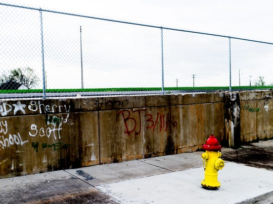 Graffiti on the side of the old football field at the former Rule High School on 1919 Vermont Ave. in Knoxville, Tennessee on Thursday, March 29, 2018. The school, named after Knoxville newspaper editor Captain William Rule, was open from 1927 until 1991 due to school district rezoning and continued deterioration of the building.