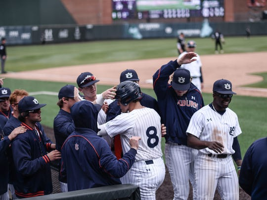 Auburn teammates mob Brendan Venter after his three-run home run in a 75- win over Mississippi State on April 15, 2018, in Auburn, Ala.