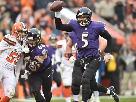 Dec 17, 2017;  Baltimore Ravens quarterback Joe Flacco (5) scores a touchdown during the second quarter against the Cleveland Browns at FirstEnergy Stadium.
