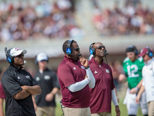 Mississippi State running backs coach Charles Huff (center) is expected to leave the program and assume the same position at Alabama.