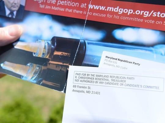 Maryland Senator Jim Mathias, holds negative GOP-funded ads that are targeting Mathias' campaign on Monday, April 23, 2018.