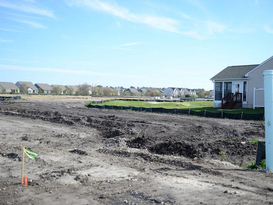 """An empty lot where more apartment building are to be built in Fairway Village. Homeowners are suing the neighborhood's developer, claiming he turned what should have been resident-owed condos into a """"rental enterprise."""""""