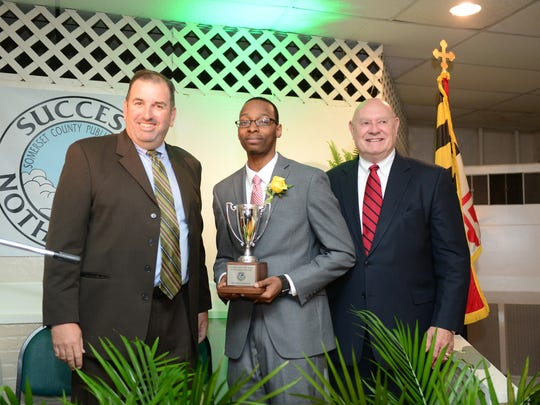 (Center) Richard Warren Jr., Science Teacher at Crisfield Academy and High School, has been named The 2018 Somerset County Teacher of the Year on Friday, April 27, 2018.