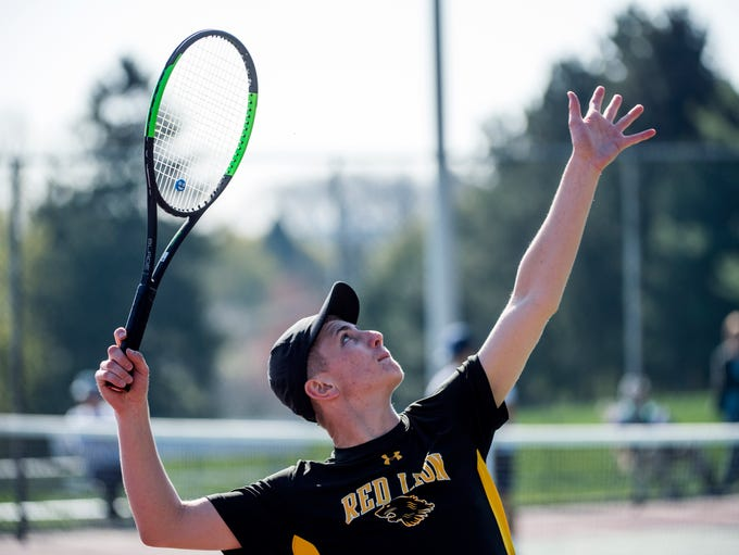 Red Lion's Alec Shue gets ready to serve to Dallastown's