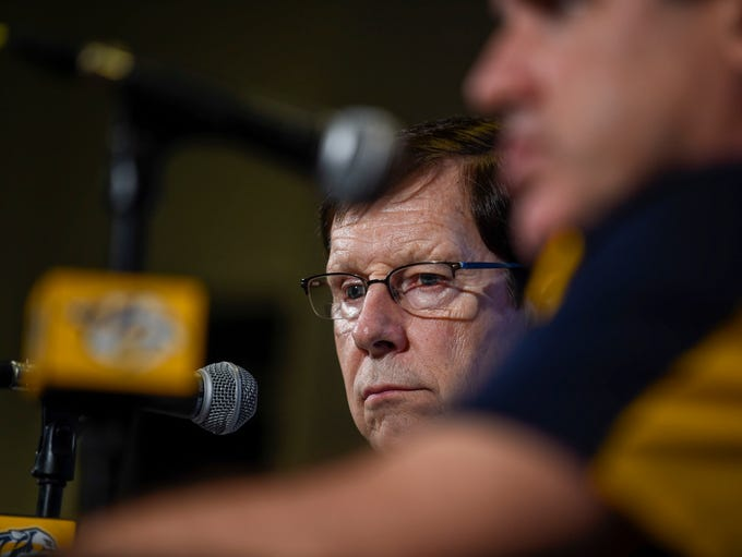 Predators General Manager David Poile listens as the