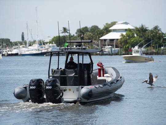 A 33-foot rigid hull inflatable boat used by the Martin County Sheriff's Office glides through the water near Sandsprit Park in Stuart.