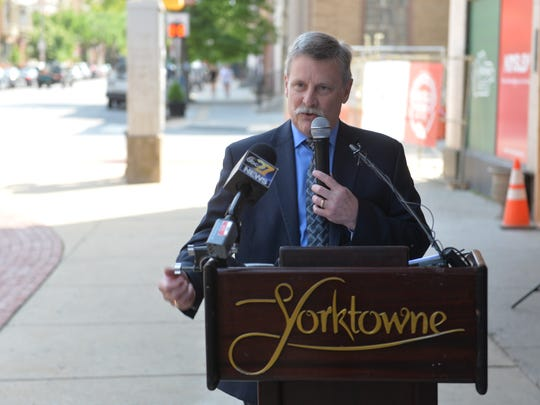 Andrew Taymans, vice president of asset and revenue for GF Management, speaks outside of the Yorktowne Hotel. GF Management will be the operators of the hotel when it opens in Fall 2019.