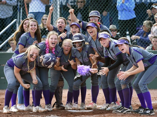 The Spanish Springs Cougars wait for Rylee Retzer to round the bases after hitting a home run to make the score 8-3 in the championship game against Douglas at Bishop Manogue on May 14. The Cougars won, 9-3.